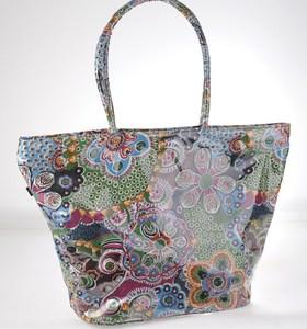 Plátěná taška z nepromokavého materiálu Kbas s květinovým vzorem modrá